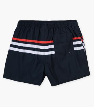 Navy swim trunks with stripes.