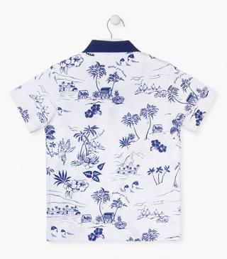 Cotton polo shirt with printed tropical motifs.