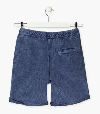 Side pocket swim trunks in blue.