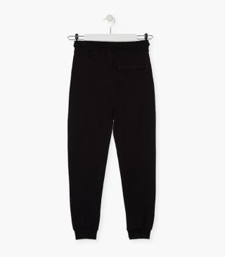 Black unnapped plush trousers.