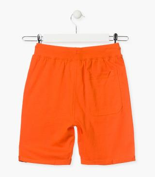 Orange shorts with graphic detail.