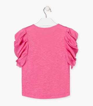 Pink t-shirt with frilled sleeves.