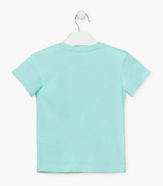 Aquamarine green top with coastal motif.