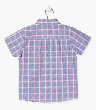 Blue checked shirt.