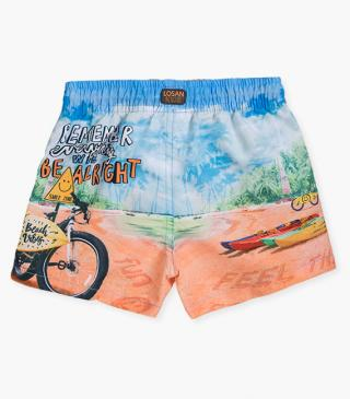 Cycling motif swim trunks.
