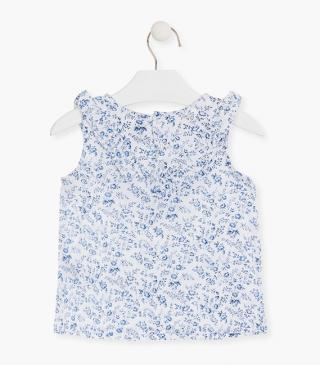 All-over blue floral print blouse.