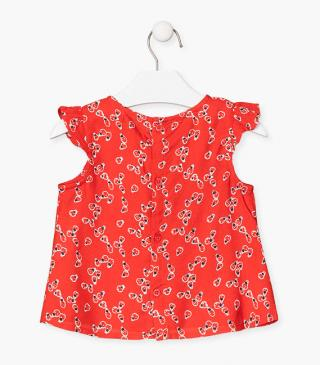 Blusa con stampa di coccinelle all-over.