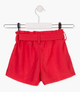 Coral red shorts with belt.