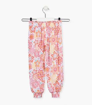 Floral print trousers in viscose.