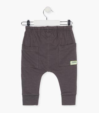 Drop crotch trousers in deep grey jersey.