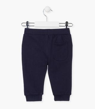 Navy blue trousers crafted from plush.