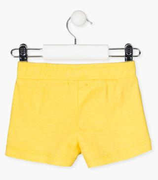 Fabric-mix shorts in yellow.