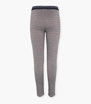 Houndstooth print trousers.