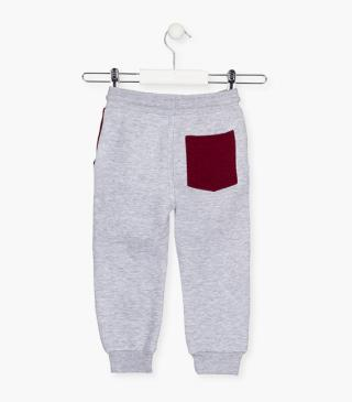 Tri-blend grey trousers with pops of burgundy.