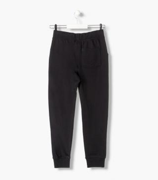 Athletic trousers with branded print.