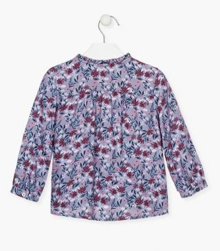 All-over floral blouse in blue.