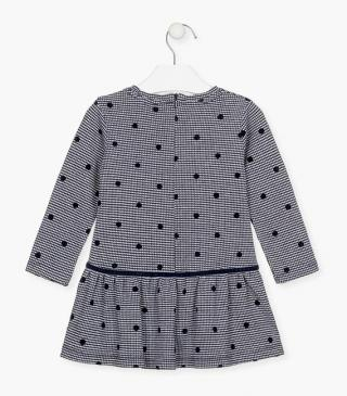 Houndstooth dress with printed dots.