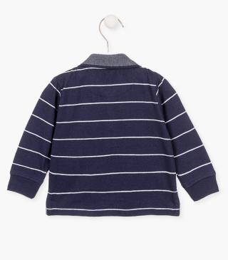 Stripy polo with embroidered detail at the chest.
