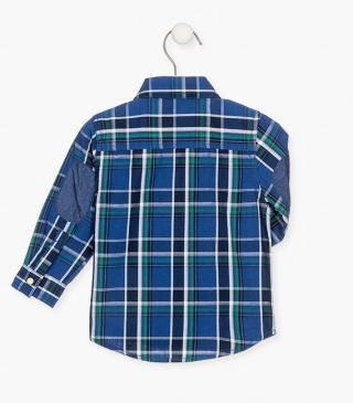 Denim elbow patch shirt in a checked fabrication.