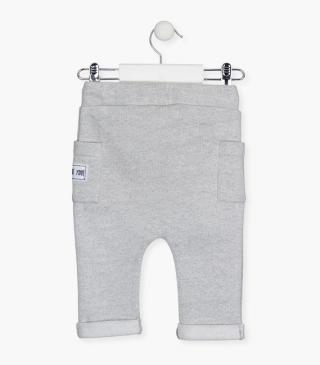 Plush trousers with side patch pockets.