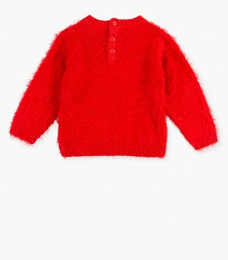Red jumper with hearts.