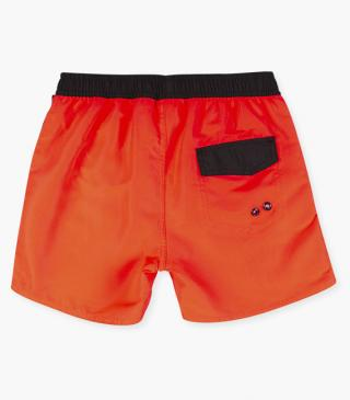 Microfiber swim trunks with plastic fastener.