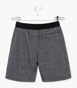 Grey shorts with zip pockets.