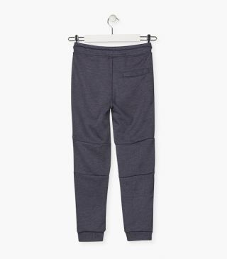 Blue knit trousers.