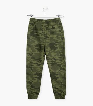 Green trousers with camo print.