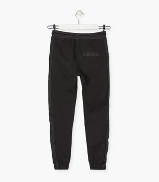 Side zip trousers.