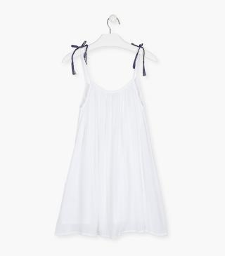 White dress in a creased fabric.
