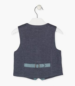 Knit vest with mock pockets.