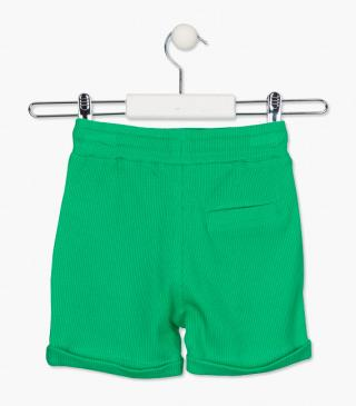 Green shorts in a knitted fabric.