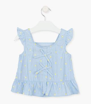 Striped sleeveless blouse in blue.