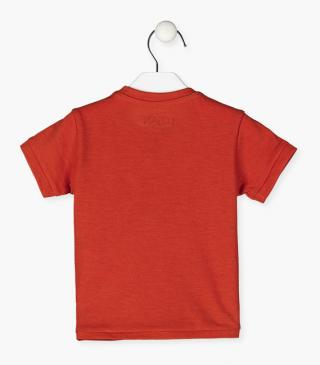 Orange t-shirt with print.