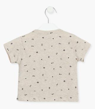 Tee with printed symbols.