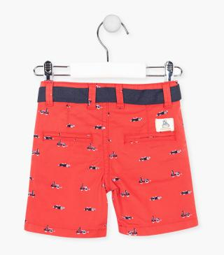 Red shorts with printed details.