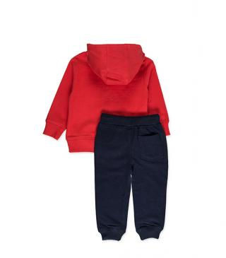 Plush tracksuit including a red jacket and blue trousers.