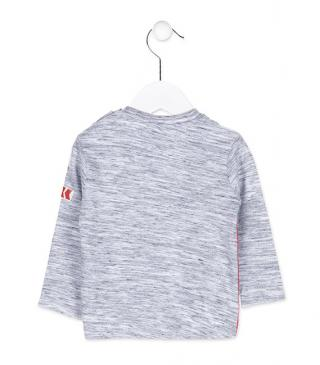 Long sleeve tri-blend t-shirt with patch on the sleeve.