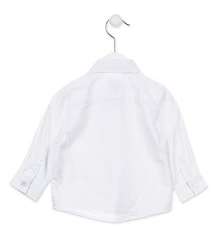 White shirt featuring long sleeves and embroidery.