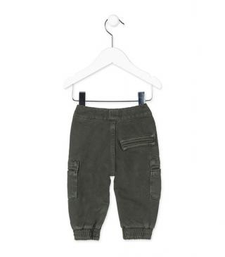 Green knit trousers with multi-pocket construction.