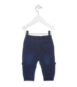 Multi-pocket trousers in denim-effect fabric.