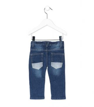 Jeans with blue concealed patches.