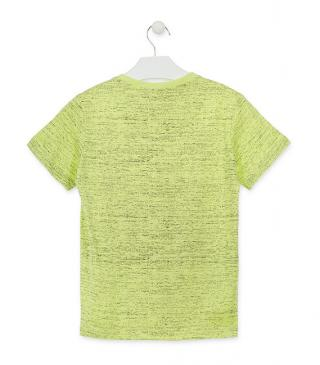 Camiseta de color verde con estampado de puntitos.