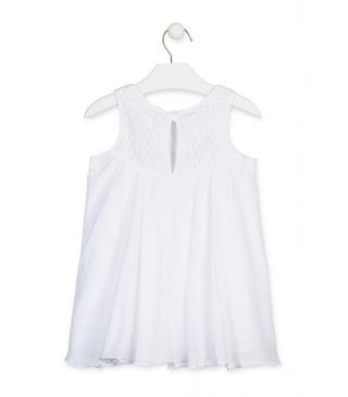 Vestido de gasa de color blanco.