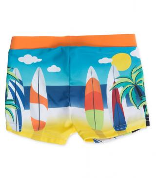 Bañador de color naranja con estampado surfero.