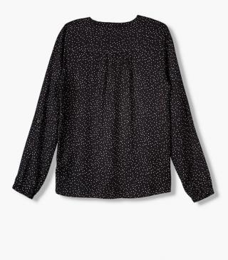 All-over dot print blouse in black.