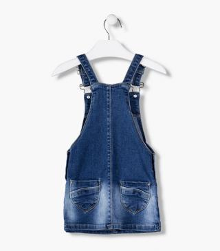 Denim dungaree with rips and interior sequin patch.