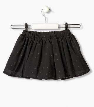 All-over glittery star print skirt.