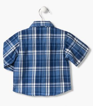 Blue check shirt.